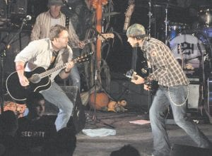 David Tolliver, left, of Hindman, and Chad Warrix, right, of Jackson, perform as Halfway to Hazard. The Nashvillebased country-rock duo performed Saturday at the Mountain Heritage Festival. (Photo by Chris Anderson)