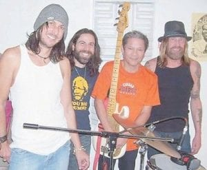 Worry Beads guitarists Mark Knight, left, and Mark Tremalgia, second from left, posed earlier this year during a recording session in Los Angels with ex- Rod Stewart Band bassist Phil Chen and Gov't Mule percussionist Matt Abts.