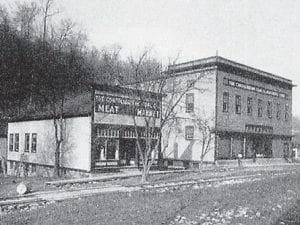 MEAT MARKET — Ella Mae Helton Pawley of Clay City sent in this photograph of the Meat Market and Consolidation Coal Company Store at McRoberts about 1913. The ice house can be seen behind the Meat Market.