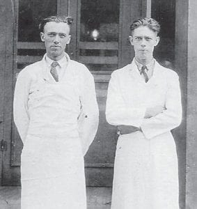 BUTCHERS — James Morton Long (1898-1983) and his brother Jesse Wilson Long (1902-1948) are pictured in front the Meat Market in McRoberts. They came from Frenchburg to work as butchers for the Consolidation Coal Company in the early 1920s. Jess Long married Edith Eva Kelly and moved to Neon where he ran the A&L Store (old yellow front) until 1936, then moved to Mt. Sterling, where he also owned a store and small farm. Mort Long married Hattie Allen Beverly of Wise, Va., and continued to work at the Meat Market for 25 years, living in Jenkins and McRoberts, before retiring to the Mt. Sterling area. Both brothers are buried in Mt. Sterling. They were the sons of Simeon De Lafayette Long and Laodicia Fugate Long. The photo and information were supplied by Ella Mae Helton Pawley.