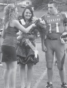 HOMECOMING — The Jenkins High School Cavaliers took on the Magoffin County Hornets Friday in the JHS homecoming game. The Cavaliers fell 61-10 to the Hornets. Storm Cox (center) was named the homecoming queen and was escorted by Charlie Cox. She was crowned by former JHS homecoming queen Dana Collier.