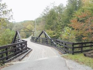 This wooden bridge was orginally built in the 1930s to provide access to Letcher County's first golf course. The property is now considered one of the county's most scenic neighborhoods. (Photos by Ben Gish)