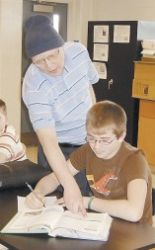 In this undated 2008 photo, Bill Sparkman is seen with 7th grade student, Jessie Roberts during a lesson about sound waves. (AP Photo/The Times-Tribune)