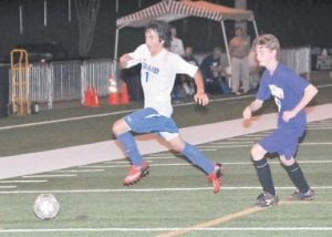 Letcher County Central's Jarvis Sokolowich chased the ball while his Buckhorn defender followed behind during the Cougars' opening round win in the boys' district soccer tournament held at Hazard Monday night.