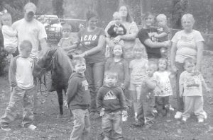 PONY RIDES — Andy Sturgill brought his pony Cocoa to Appalachian Early Child Development Center on Farm Day, Oct. 9. The children took turns riding the pony and feeding him apples. Pictured are (front row, left to right) Luke Sturgill, Isaiah Sexton, Nikolai Sexton, Kiera Couch, Emily Stone, Jermiah Hurt, Brooke Lucas, Avery Mullins, (back row) Chloe Sturgill, Andy Sturgill, Kendall Larue, Terri Ratliff, Jackie Boggs, Grant Barto, Monique Sexton, Caden Combs, and Dwana Quillen.