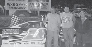 THE #11 CREW of Oscar McCown, Greg Hampton, and Clint Thomas battled it out all year in the Limited Late Model feature. They brought in their fifth win Friday night at Mountain Motor Speedway's last race of the seacon. Photo by Jodie Smallwood.