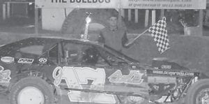 A NEW FACE at Isom Friday night left with a win. Jimmy Arnett in car #J17 led every lap in the Open Wheel Modified feature. Photo by Jodie Smallwood.