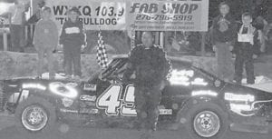 A WIN, A WRECK — Tim Mason in car #45, a veteran racer at Mountain Motor Speedway, drove in two races Friday night. In the Late Limited Model class, he qualified second and led the race a couple of laps before a wreck. In the Bomber feature, he came out with the win. Photo by Jodie Smallwood.