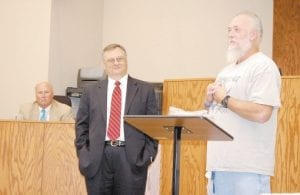 NEW DRUG COURT GRADUATE — Alan Adams, of Mayking, talked about his hardships and how he has changed for the better during the Letcher County Drug Court graduation on Oct. 8 in the Letcher Circuit Courtroom. State Sen. Johnny Ray Turner (far left) and Letcher Circuit Judge Sam Wright are seen listening to Adams. (Photo by Sally Barto)