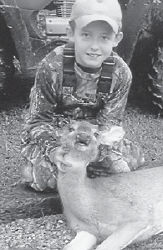 YOUNG HUNTER — Jacob Boggs killed this button buck during the recent Youth Hunt with his uncle Cameron Combs. Jacob is the son of Rich and Crystal Boggs of Ermine, and is a grandson of Kay and Leonard Boggs of Cowan and Joe and Terese Combs of Isom.