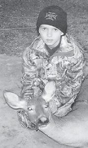 DEER HUNTER — Kane Gibson killed this doe during the recent Youth Hunt with his father. He is the son of Owen and Nikki Gibson and a grandson of Leonard and Kay Boggs, all of Cowan. He is also a grandson of Codell and Debby Gibson of Craft's Colly, and Carlene and Kenneth Oliver of Paris, Ky.