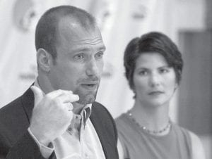 This is an Aug. 30, 1999, file photo showing former Cleveland Browns linebacker Chris Spielman, left, at a news conference with his wife, Stefanie, in Berea, Ohio. Stefanie has been battling breast cancer since it was first diagnosed in 1998. (AP Photo/Mark Duncan)