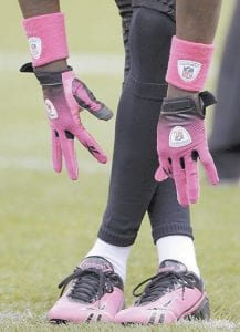 Cincinnati Bengals wide receiver Chad Ochocinco wears pink gloves and shoes during warmups for the Bengals' NFL football game against the Cleveland Browns on Oct. 4, 2009, in Cleveland. Several players wore pink during National Breast Cancer Awareness Month. (AP Photo/Amy Sancetta)