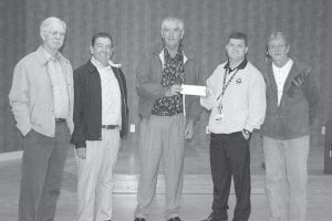 Letcher County Clerk Winston Meade presented a $6,500 check to Neil Napier, program supervisor of the Eastern Kentucky Veterans Center, in Hazard on Oct. 20. Funds, used to provide a new hardwood floor in the auditorium of the veterans center, were raised by selling recycled license plate birdhouses in area clerks' offices. Pictured from left are Leslie County Clerk James Lewis, Buddy Grubb, chairman of the Letcher County Veterans Museum, Meade, Napier and Joe Bolton, board member of HOPE for Veterans.