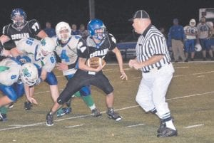 LOOK OUT, REF! — Letcher County Central senior running back Greg Collins broke away from the pack in the Cougars' senior night win over North Laurel. See story, Page B1.