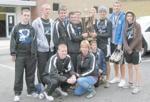 Members of the LCCHS boys' cross country are (standing, left to right) Kevin Collier, Nick Cook Jake Dixon, Brandon Hamilton, Tyler Smith, Eric Fields, Cody Gregory, James