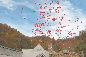 BALLOONS SIGNIFY DRUG-FREE PLEDGES — Biodegradable red balloons were released into the air last week in observance of Red Ribbon Week at the Whitesburg Campus of Southeast Kentucky Community and Technical College. At least 250 balloons were released on the college campus as a way to increase public awareness of the advantages of being drug free. The Letcher County Prevention Project provided the balloons. (Photo by Sally Barto)