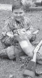 YOUNG HUNTER — Thirteen year-old Aaron Creech killed his first deer at Gordon during during Youth Hunt weekend while hunting with his father. He is the son of Catherine and Sonny Creech of Linefork, and is an eighth-grade student at Cowan Elementary School.