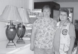 WINNER — Norma Adams of Eolia (left) was the winner of a set of lamps in a fundraiser by the Partridge Cumberland River Area Lions Club. The lamps were donated by Hoover's Home Furnishings. She is pictured with Jan Galloway, president of the Partridge CRA Lions Club.