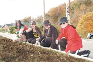 STUDENTS SAY NO DRUGS — In honor of Red Ribbon Week, an anti-drug initiative, Southeast Kentucky Community & Technical College students Auri Bolen (left), Priscilla Hogg, Martha Frazier and Jessica Stines planted red tulips on the school's Whitesburg campus on Oct. 29 as a pledge to