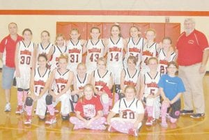 The Martha Jane Potter Elementary School Lady Cardinals basketball team wore pink socks during their game against the Cowan Elementary School Lady Bulldogs on Oct. 31 in observance of Breast Cancer Awareness Month. Pictured are (front row, left to right) Lindsay Bentley, Sara Craft, (second row) Brittany Wright, Victoria Bates, Ally Damron, Kristiana Ballou, Rachel Lucas, Tayler Fleming, Grayson Collier, (back row) Assistant Coach Mark Wright, Taylor Ison, Linsey Tyree, Shea Rose, Samantha Tubbs, Kaitlynn Whitaker, Alley Bolling, Kristina Bentley, Meg Raleigh, Cameron Kincer and Coach Bumper Adams.