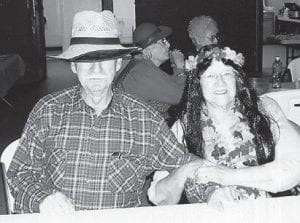 IN COSTUME — Pictured are farmer Rhuford Hart and his wife Coleene in the Hawaiian costume that won her a prize at a Halloween party at the Kingscreek Senior Citizens Center.