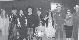 HALLOWEEN PARTY — Pictured at a Halloween party hosted by the Kingscreek Senior Citizens Center are (left to right) Barbara, Debbie, Ruby, Lydia, Lizzie Mae, Coleene, John, Kathy, and Carl. In the front is Kyledia.