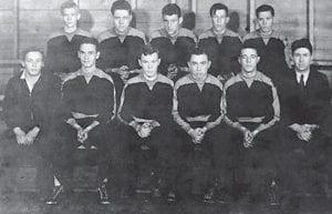 1933-34 WHITESBURG HIGH SCHOOL BASKETBALL TEAM — Left to right front row: Ralph Polly, Pat Blair, Frank Webb, Lum Haynes, Earl Amburgey, Dick Bourne, Coach. Back row: Bert Day, Carl Holbrook, Clayton Day, Ralph Adkins and Arnold Amburgey.