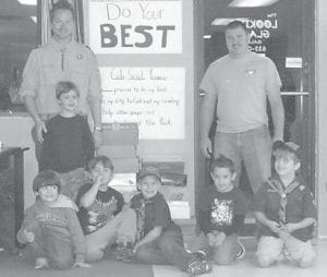 GIFT BOXES — The Tiger Clubs, Unit 820, filled 25 shoeboxes for Operation Christmas Child. The scouts are students at West Whitesburg and Cowan Elementary Schools. Picture are (clockwise, left to right) Den Leader B. Keith Adams, Wyatt Ison, Dylon Pike, Dalton Brock, Zackary Cornett, Brody Napier, Aidan Adams, and Den Leader B.J. Pike.