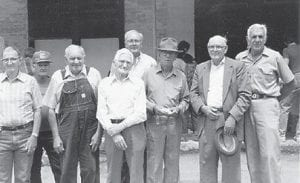 REUNION — These former Marlowe residents stand in front of the Marlowe store at a reunion which took place