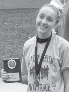 DISTRICT CHAMP — Kelsey Mullins a junior at Letcher County Central High School, won the female division of the Area 9 District Championship at Harlan County on Oct. 24, setting a new course record. She finished in seventh place in Lexington at the Meet of Champions the following weekend.
