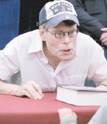 Author Stephen King made a face at 3-1/2 year old Jason Brock, unseen, who had King sign his new book,