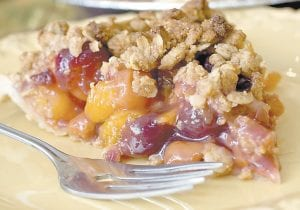 A slice of pie on Thanksgiving is as traditional as a serving of turkey. You can make this tradition healthier by making good choices when choosing the crust. This cherry-apricot crumb pie is topped with a low-fat oat crumble made with whole-wheat flour that helps reduce any dietary regret. (AP Photo/Larry Crowe)