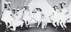 """ATOMIC DARLINGS — Faculty members at Whitesburg High School appeared in a dance revue, 'The Atomic Darlings of 1955'. Pictured are (left to right) Ed Moore, football coach; Sonny Boyd, assistant coach; Ray Pigman, baseball coach and director of athletics; Kendall Boggs, """"misleading ballerina"""" and principal of the school; Bill Collins, mathematics instructor; Cecil Caudill, science instructor; and Walter Enlow, social science instructor."""
