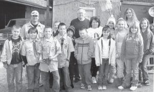 "SCOUTS — Cub Scout Troop 856 and Girls Scout Troop 1436 joined together for a food drive for ""God's Love from a Diaper Bag', a community service organization run by Lester and Bessie McPeek. Pictured are Todd Bailey, Steven Anderson, Mason Jessey, Cody Adams, Matthew Bailey, Ethan Back, Jayce Gibbs, Cub Scout Troop Leader Paul Dugan, Katlyn Fosskuhl, Makayla Dugan, Makayla Briggs, Trinity Beauparlant, Crystal Bailey, and Girl Scout Troop Leader Kimberly Bailey."