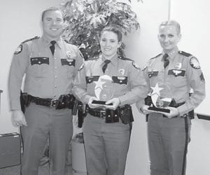 HONORED — Pictured with Kentucky State Police Captain Scott Miller are KSP members who were honored recently, Trooper Jennifer Sandlin and Sergeant Jacqualine Pickrell.