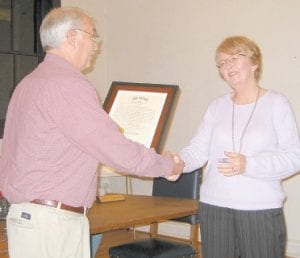 Whitesburg Mayor James W. Craft presented a plaque in memory of the late Rev. Jack Sparks to Trina Sparks.