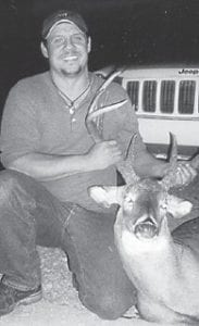 HUNTER — Corbin Joe Joseph of Linefork, killed this nine-point buck on Nov. 14 in the Linefork area.