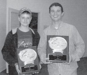 ANGLERS — Peyton Absher (left) is the winner of the Youth Angler of the Year presented by the Letcher County Christian Anglers at the year end awards banquet recently. Phillip Little is the winner of the Angler of the Year. Both are residents of Cowan.