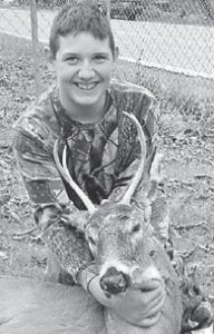 YOUNG HUNTER — Thirteen year-old Joseph Ellish killed this five-point buck in Carter County while hunting in November with his grandfather, his uncle, and his cousin. He is a eighth-grade student at Fleming-Neon Elementary School and is the son of Melissa and Johnny Collins. His grandparents are Jimmy and Starla Hampton of Hemphill.