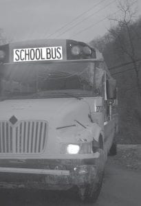 NO INJURIES — A Letcher County school bus knocked down a power pole in Craft's Colly around 3:30 p.m. on Dec. 7. According to WYMT-TV the bus driver, Gary Anderson, said he swerved to keep from hitting an animal on the road. Roger Martin, director of finance for the Letcher County School System, said two students were on board bus no. 2703 at the time of the accident. Martin said neither child was injured but one was examined at Whitesburg hospital. Traffic was blocked at the accident site for more than two hours while American Electric Power Company workers removed the pole and electric wires from the road.