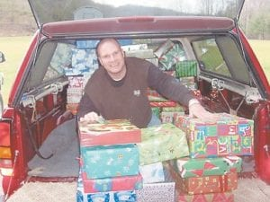 CHRISTMAS CHEER — B.J. Kilbourne, an ECCO volunteer, unloads Christmas gifts from a church in Vandalia, Ohio.
