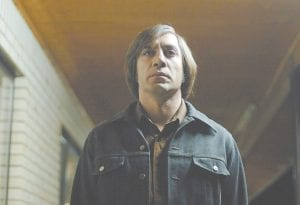"""This file photo released by Miramax shows actor Javier Bardem as Anton Chigurh in a scene from """"No Country for Old Men."""" (AP Photo/Miramax Films)"""