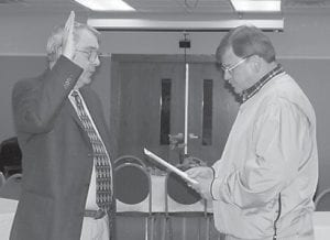 JOINING LIBRARY BOARD — Carl Banks (left) is sworn in as the newest member of the Letcher County Library Board of Trustees by Letcher County Judge/Executive Jim Ward. Banks was appointed to the board by the fiscal court in October. He retired as the finance officer of Mountain Comprehensive Health, and has been a teacher in the Letcher County Schools. He is an avid genealogist and a historian, and is married to Marsha Banks. The other members of the library board are President Jeanette Ladd, Vice President Mahala Frazier, Secretary Margaret Lewis, and Treasurer Jo Combs.
