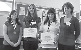 STUDENTS COMPETE — Students from the Letcher County Area Technology Center participated in regional HOSA competition and leadership activities Dec. 1 at the Cumberland Campus of Southeast Kentucky Community and Technical College. Sierra Caudill finished third in pathophysiology, Brooke Back was first in medical math, and Danielle Vanover was first in personal care skills. The students were accompanied by their instructor Vivian Back. Dr. Bruce Ayers presented each first-place winner with a $250 scholarship to SKCTC. The students will advance to state competition in Louisville in March.