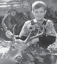 FIRST DEER — Seven-yearold Taylor Hall, son of Shane and Marlene Hall of Ermine, killed his first deer, an 8- point buck, Nov. 21 in Knott County. He is a secondgrade student at West Whitesburg Elementary School.