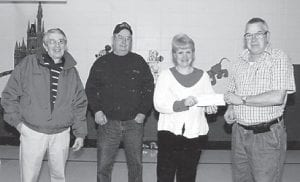 DONATION — Roger Profitt recently presented $500 to Lisa Carroll, principal of Jenkins Independent Schools, to buy Christmas stockings stuffed with candy and fruit for 226 students at Burdine Elementary School. Pictured are (left to right) Jenkins Mayor Charles Dixon, school volunteer David Little, Carroll, and Profitt.