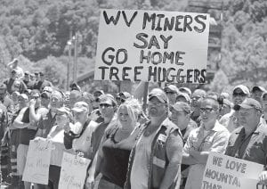 Massey Energy miners protested in Sundial, W.Va., in June. Tension has been building for months as activists mount sometimes brazen acts of civil disobedience to stop mountaintop removal mining as it gains closer scrutiny from regulators, policy makers and the public. (AP Photo)