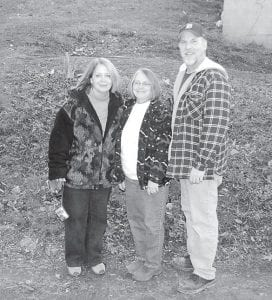 Mary Martin Hendrian, Janet Madden and Jim Hendrian took a break from delivering Christmas presents to needy families on Dec. 17 and posed for a photo in Jenkins. (Eagle photo)