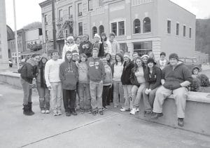 """SPREADING CHRISTMAS CHEER — The Whitesburg Middle School UNITE Club spent the morning of Dec. 18 singing Christmas carols in downtown Whitesburg. UNITE stands for Unlawful Narcotics Investigation Treatment and Education. A short video clip of the group singing """"We Wish You A Merry Christmas"""" can be viewed at www.themountaineagle.com. (Photo by Sally Barto)"""